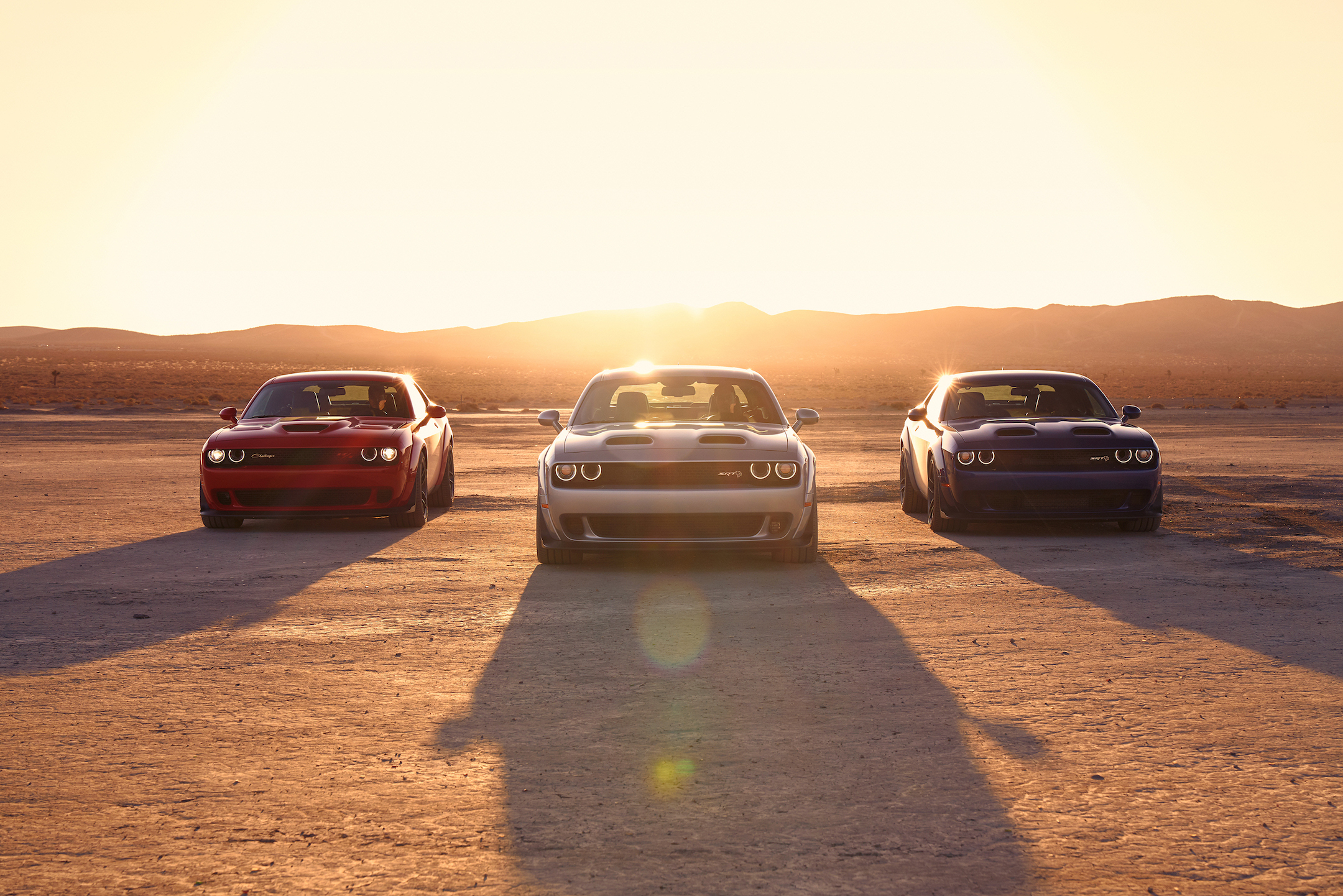 2019 Dodge Challenger Lineup: R/T Scat Pack Widebody, SRT Hellcat Redeye Widebody, SRT Hellcat Widebody (from left to right)