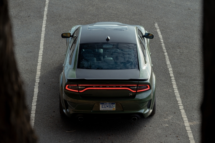 2020 Dodge Charger Scat Pack Widebody in F8 Green exterior color with Satin Black Painted hood, roof and deckli.