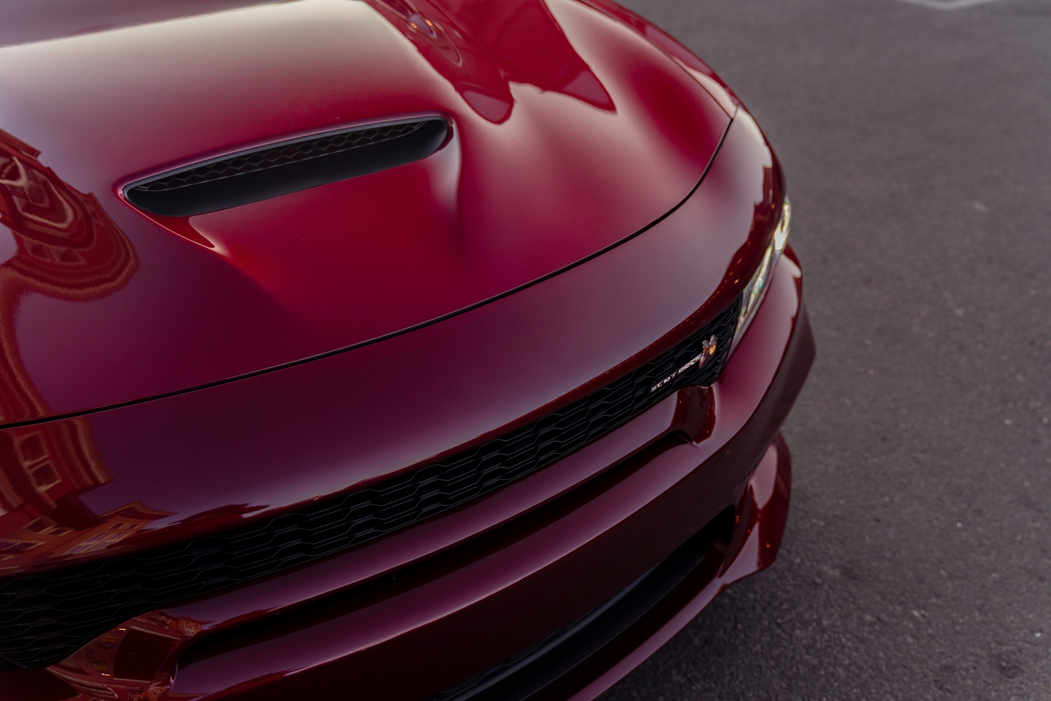 Beyond its menacing stance, the newly designed front fascia on the Charger Scat Pack Widebody includes a new mail-slot grille, providing the most direct route for cool air to travel into the radiator, to maintain ideal operating temperature even in the hottest conditions.